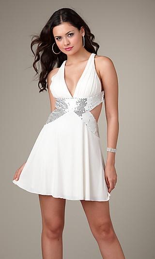 Vestido corto muy ceñido en color atigrado. Es modelo definitivamente sexy, con este vestido lucirás un cuerpo de infarto, ya que va ceñido en toda la parte del vestido.